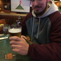 Photo taken at Smokey Bones Bar & Fire Grill by Mike A. on 2/21/2015