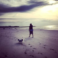 Photo taken at Sea Street Beach by emily g. on 5/10/2013