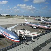 Photo taken at Miami International Airport (MIA) by Julio B. on 6/22/2013