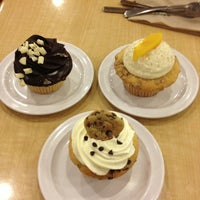 Photo taken at Molly's Cupcakes by Lauren M. on 2/11/2013
