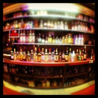 Photo taken at Ola's Liquors by Mat T. on 7/24/2013