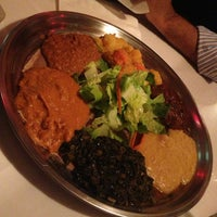 Photo taken at New Eritrea Restaurant & Bar by Melissa D. on 10/13/2013