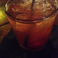Photo taken at Bourbons Bistro by Christy S. on 7/5/2014