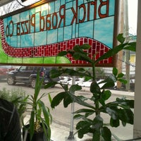 Photo taken at Brick Road Pizza Co. by Jessica R. on 3/9/2013