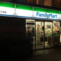 Photo taken at ファミリーマート 中洲二丁目店 by Kaoru S. on 4/7/2014
