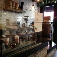 Photo taken at Nolita Mart & Espresso Bar by Jane L. on 11/8/2014