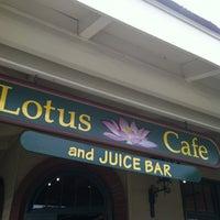 Photo taken at Lotus Cafe & Juice Bar by Ginny K. on 1/27/2013