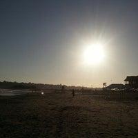 Photo taken at Easton's Beach by Chris R. on 7/5/2013