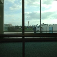 Photo taken at Gate 26 by Karla A. on 1/2/2013