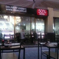Photo taken at Niu Sushi by Fernanda on 2/23/2012