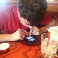 Photo taken at Red Robin Gourmet Burgers by Brandy B. on 2/14/2013