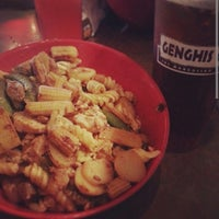 Photo taken at Genghis Grill by Baochau T. on 4/4/2014