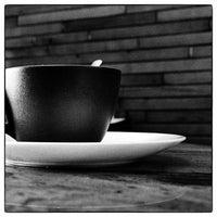 Photo taken at T'M Café by Didier L. on 4/12/2014