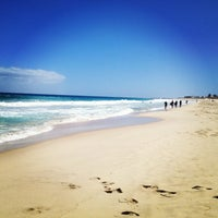Photo taken at Scarborough Beach by Delphine R. on 2/28/2013