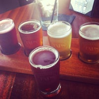 Photo taken at Taps Wine & Beer Eatery by jenna m. on 9/3/2012