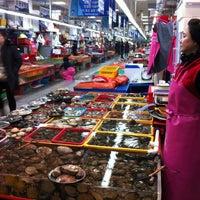 Photo taken at Jagalchi Fish Market by Mew M. on 2/18/2013