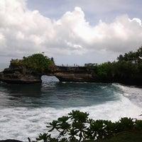 Photo taken at Tanah Lot Beach by Aprilia S. on 3/28/2013