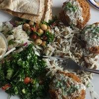 Photo taken at Tarek's Cafe by Kelly M. on 7/3/2013