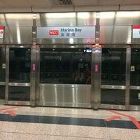 Photo taken at Marina Bay MRT Interchange (NS27/CE2) by ERTAN D. on 11/27/2016