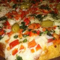 Photo taken at Pizzeria Mi Tio by Marcos S. on 4/6/2013