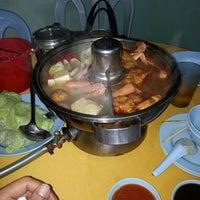 Photo taken at Restoran Yuen Buffet Steamboat by Tengku ezany T. on 12/28/2013