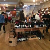 Photo taken at Cork Market & Tasting Room by Cesar C. on 12/12/2015