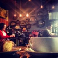 Photo taken at Vinyl Coffee & Wine Bar by Eric J. on 3/29/2013
