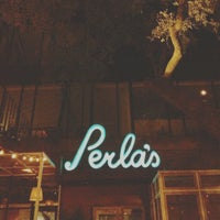 Photo taken at Perla's Seafood and Oyster Bar by Nguyen D. on 11/11/2012
