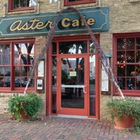 Photo taken at Aster Cafe by Nathan C. on 9/5/2013