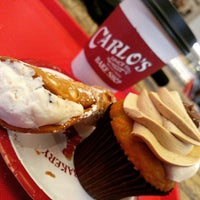 Photo taken at TLC Cake Boss Cafe by Victor R. on 4/10/2015