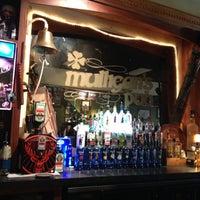 Photo taken at Mulligan's Irish Pub by Charlotte G. on 12/1/2012