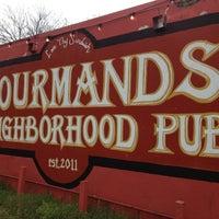 Photo taken at Gourmands Neighborhood Pub by Erik M. on 3/9/2013