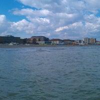 Photo taken at Beach by Antonio M. on 3/31/2013