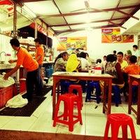 Photo taken at Indomie Abang Adek by Ivan C. on 8/1/2012