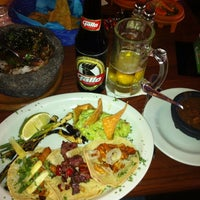 Photo taken at Los Cebollines by Andrew S. on 2/18/2012