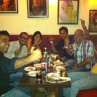 Photo taken at Cafe Morrison by Sanjay V. on 3/30/2012