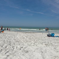 Photo taken at Tiki Gardens Beach Spot by Chrissy T. on 4/6/2014