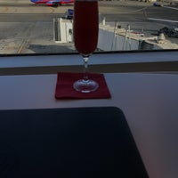 Photo taken at Virgin Atlantic Clubhouse Lounge by Phil R. on 10/14/2016