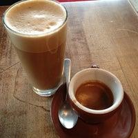 Photo taken at Café Olimpico by Stephanie G. on 3/24/2013