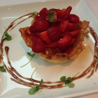 Photo taken at Fig & Olive by G A. on 9/7/2013