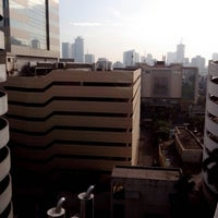 Photo taken at Permata Bank Tower Sudirman by Luk M. on 12/20/2012