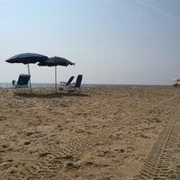 Photo taken at 76th Street Beach by Jason M. on 9/4/2015