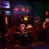 Photo taken at The Mojo Lounge by Patricia S. on 12/7/2014