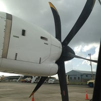 Photo taken at A.N.R. Robinson International Airport (TAB) by Horacio H. on 7/26/2013