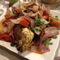 Photo taken at Mamita Peruvian Restaurant by Chauney B. on 8/12/2012