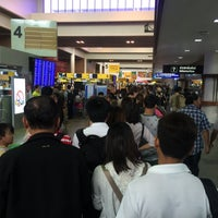 Photo taken at Don Mueang International Airport (DMK) by Sam T. on 7/20/2015