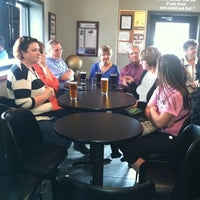 Photo taken at Scratchtown Brewing Company by Tina L. on 4/17/2015