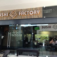Photo taken at Sushi Factory by Thomas H. on 6/6/2013