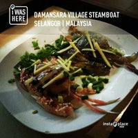 Photo taken at Damansara Village Steamboat by Jasoиteh.com on 5/24/2013