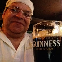 Photo taken at Tigín Irish Pub and Restaurant by Bob T. on 8/23/2015